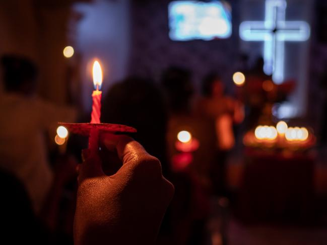 Christians hold candles during Christmas Eve mass at a church on December 25, 2018 in Carita, Banten province, Indonesia. Picture: Ulet Ifansasti/Getty Images