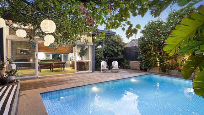 It also has a pool surrounded by tropical plants.