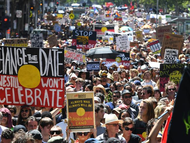 Invasion Day protesters gathered in large numbers in Melbourne, marching on Federation Square. Picture: James Ross