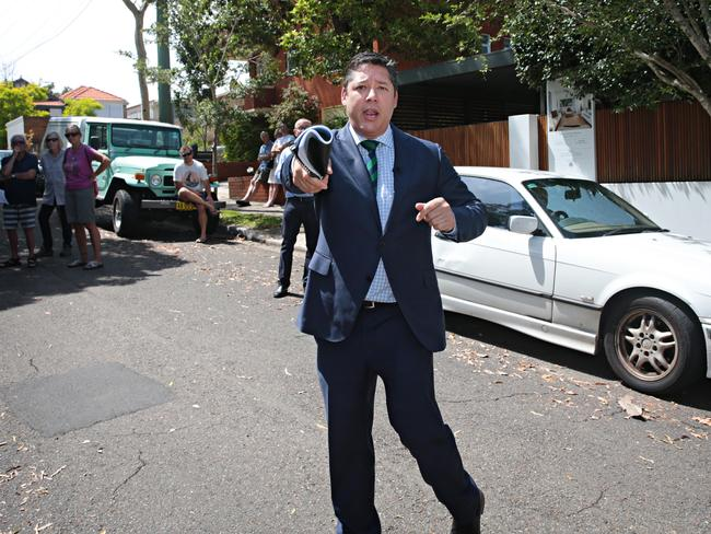 Chief auctioneer Scott Kennedy-Green (below) in full flight at today's auction. Picture: Adam Yip