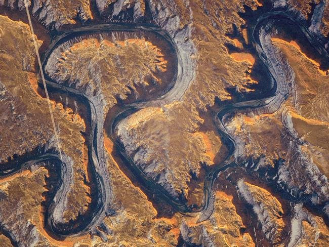 This section of the Green River canyon in eastern Utah is known as Bowknot Bend because of the way the river doubles back on itself. The loop carries river rafters 14.5 kilometres before bringing them back to nearly the same point. Picture: NASA