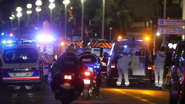 Police officers and rescue workers arrive at the scene in Nice, scene of the latest terror attack. Picture: Valery Hache/AFP