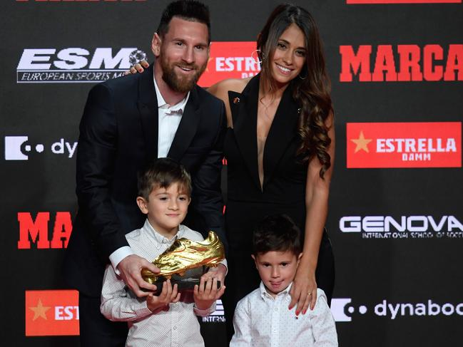 Messi with his wife and sons Thiago and Mateo. (Photo by Josep LAGO / AFP)