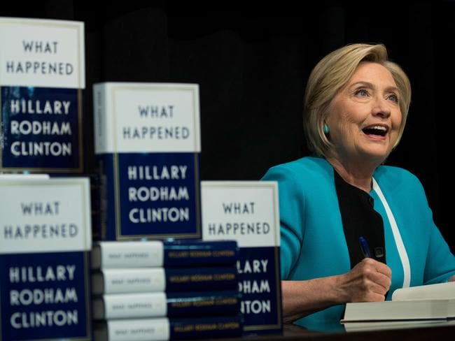 Hillary Clinton signs copies of her new book What Happened in New York City. Picture: Drew Angerer/Getty Images/AFP