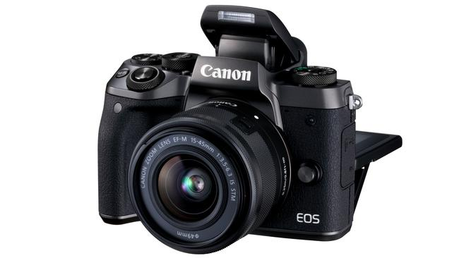 Canon's EOS M5 mirrorless camera lets photographers use legacy lenses.