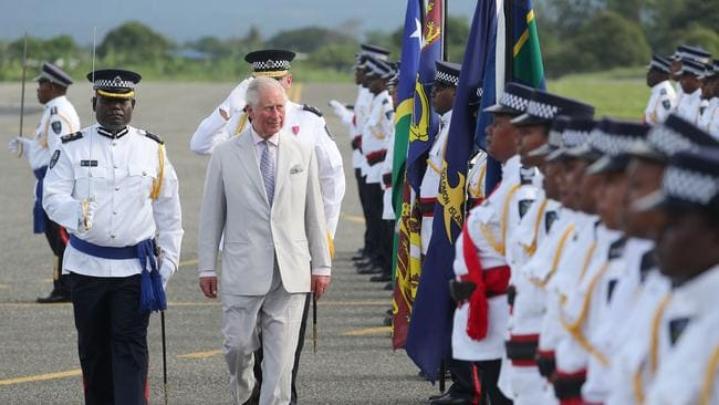 He was given a guard of honour as he left Honiara. Picture: Chris Jackson/Getty Images