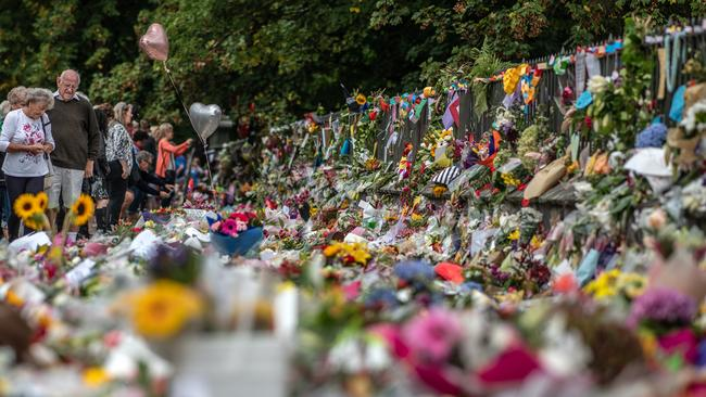 People view flowers and tributes by the botanic gardens on March 19, 2019 in Christchurch, New Zealand. Picture: Carl Court/Getty Images.