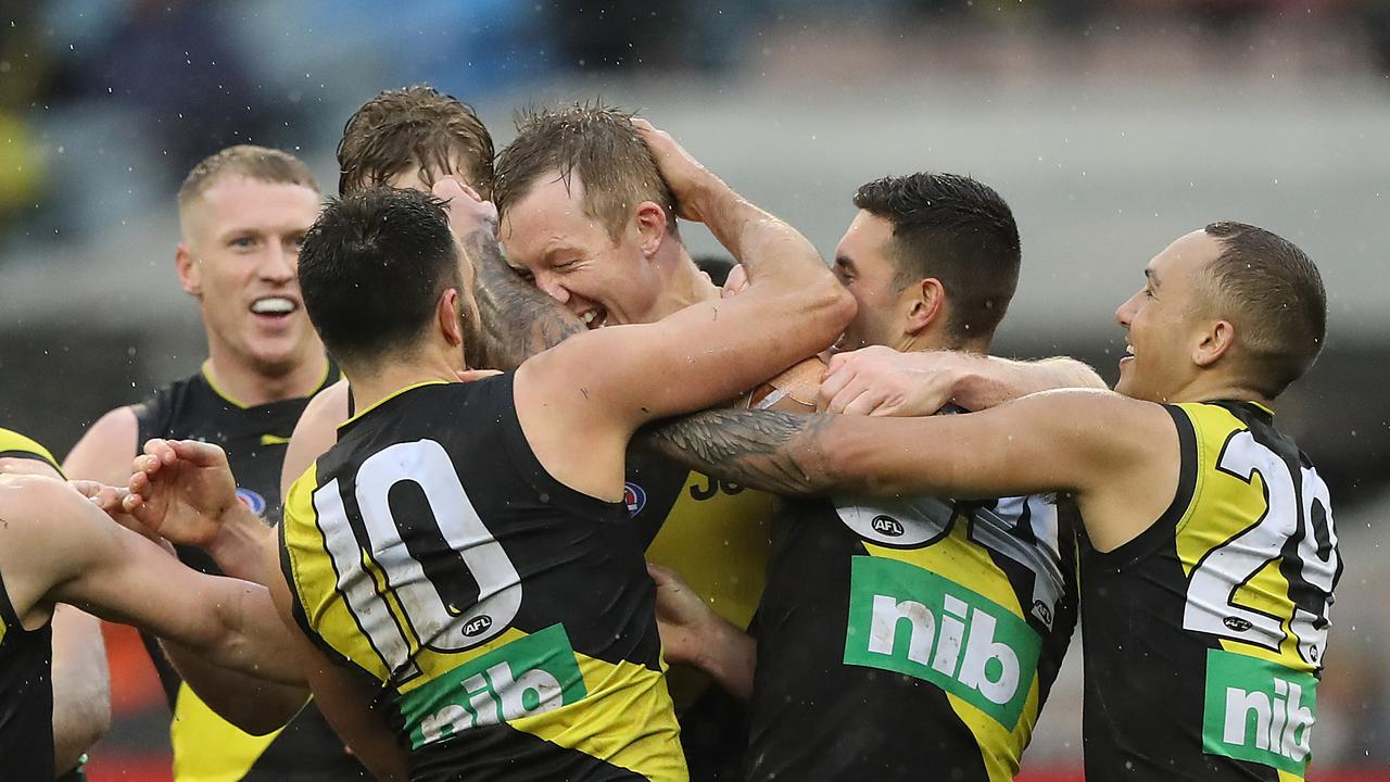 Richmond players celebrate a goal at the MCG on Sunday.