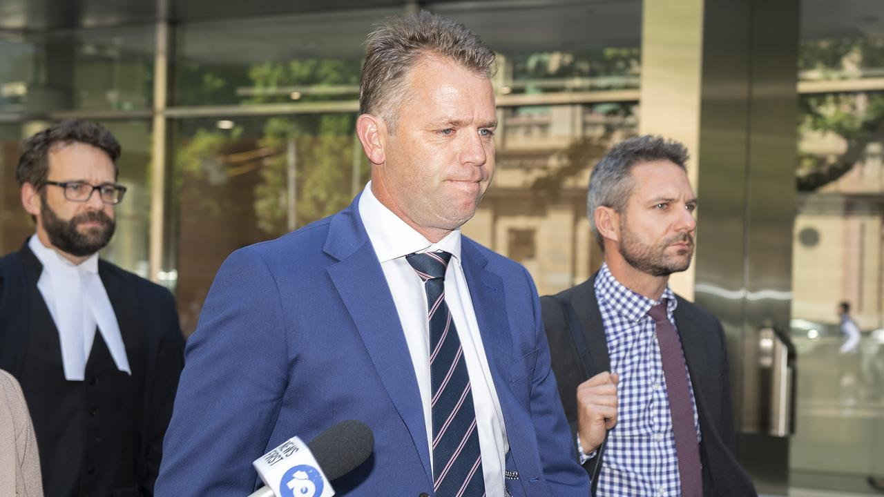Former AFL player Glenn Archer successfully appealed against his conviction for assaulting a volunteer runner at a junior football game.