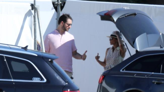 Serena Williams' husband Alex Ohanian and Meghan Markle chatting during the event. Picture: Splash