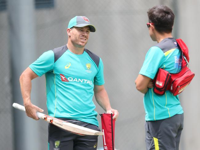 Australian team physio David Beakley and David Warner in the nets.