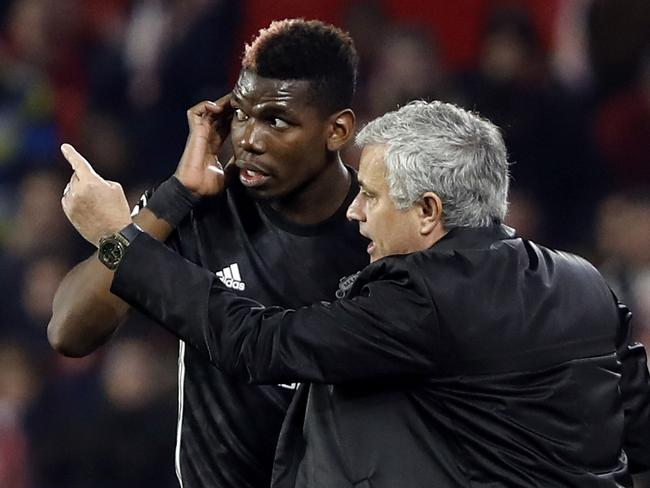 Manchester United manager Jose Mourinho, right, talks to Manchester United's Paul Pogba