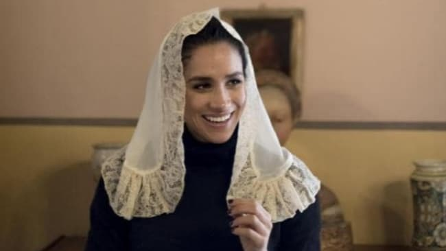 Meghan tried on headdresses worn by local women. Photo credit: Kurt Arrigo/MEGASource:Mega