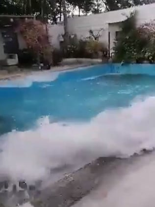 A hotel pool is shaken during the earthquake.