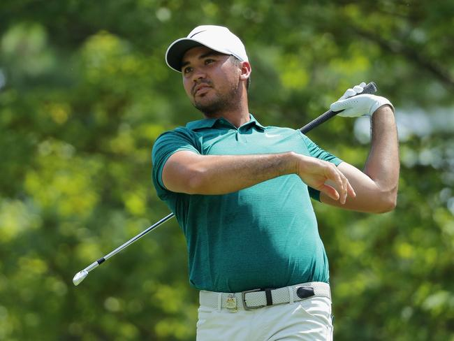Jason Day will have to grind it out after the second round was suspended. Picture: AFP