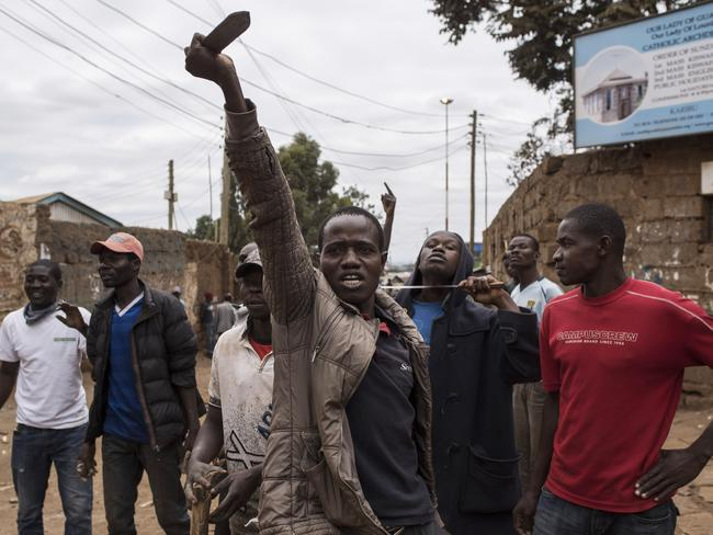 Opposition supporters taunt Kenyan police forces as the two sides clashed in the in the Kibera slum. Picture: Getty Images