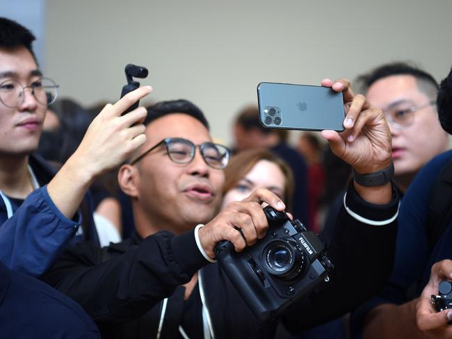 A man tries out a new Apple iPhone 11 Pro. Picture: AFP