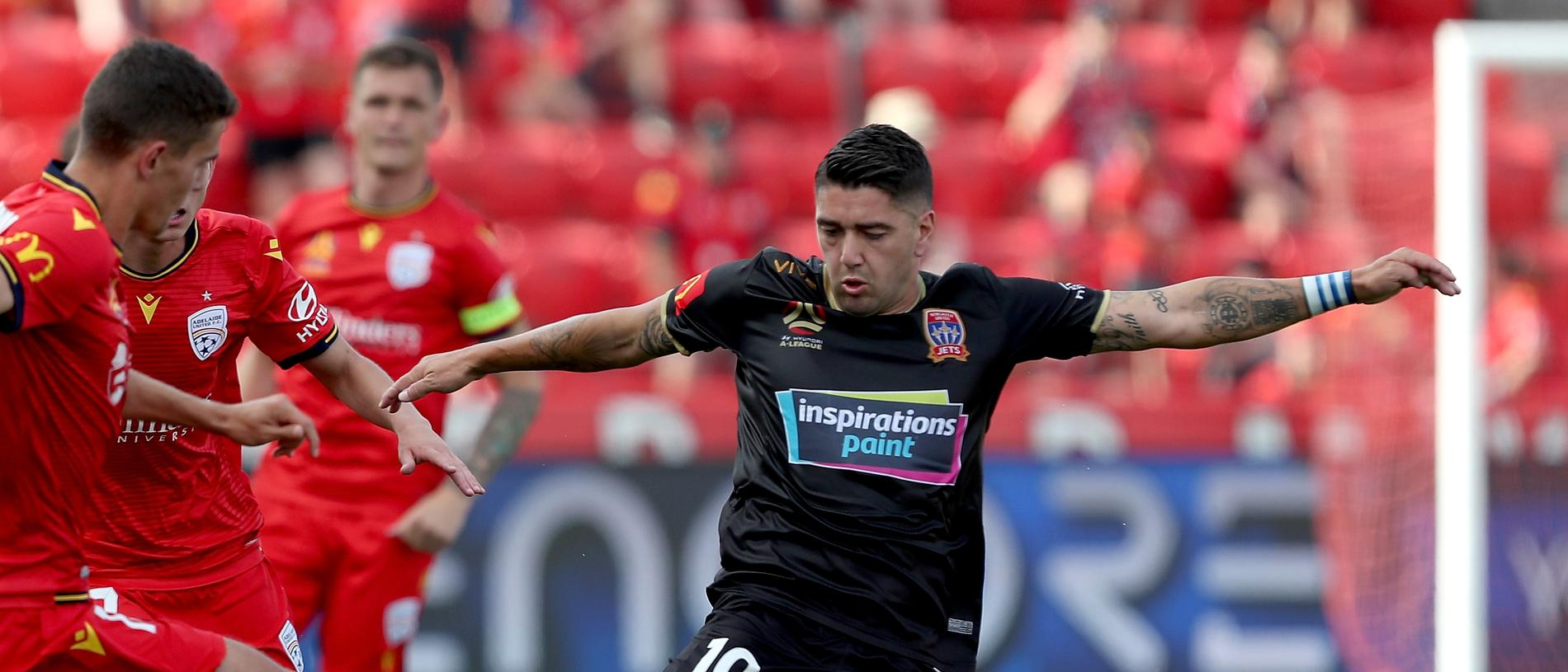 George Blackwood of Adelaide United tackles Dimitri Petratos of the Newcastle Jets during the Round 9 A-League match between Adelaide United and Newcastle Jets at Coopers Stadium in Adelaide, Sunday, December 8, 2019. (AAP Image/James Elsby) NO ARCHIVING, EDITORIAL USE ONLY