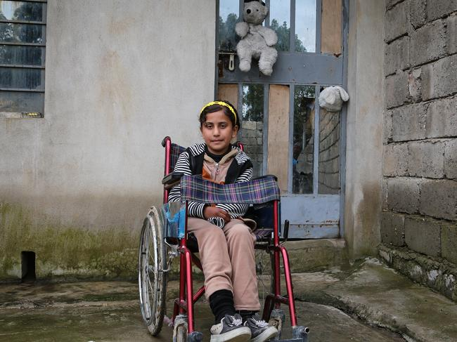 Raja, 10, lives in West Mosul. She was badly injured by a bomb during the battle for Mosul. She lost her left hand and her legs and feet were injured and she can't walk on them.
