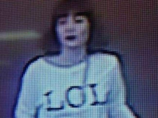The suspect in her LOL t-shirt.