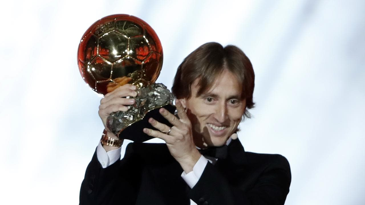 Real Madrid's Luka Modric celebrates with the Ballon d'Or award