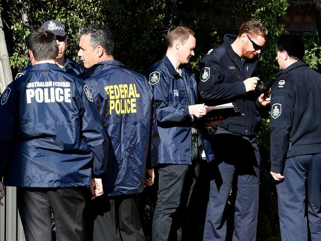 Officers outside a property in Seabrook, 19km outside Melbourne.
