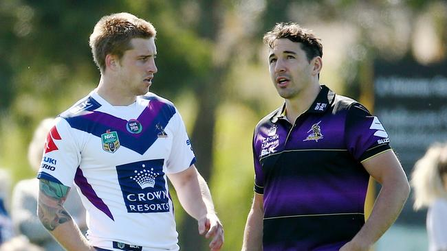 An injured Billy Slater talks with Cameron Munster during training in 2015. Picture: Colleen Petch.