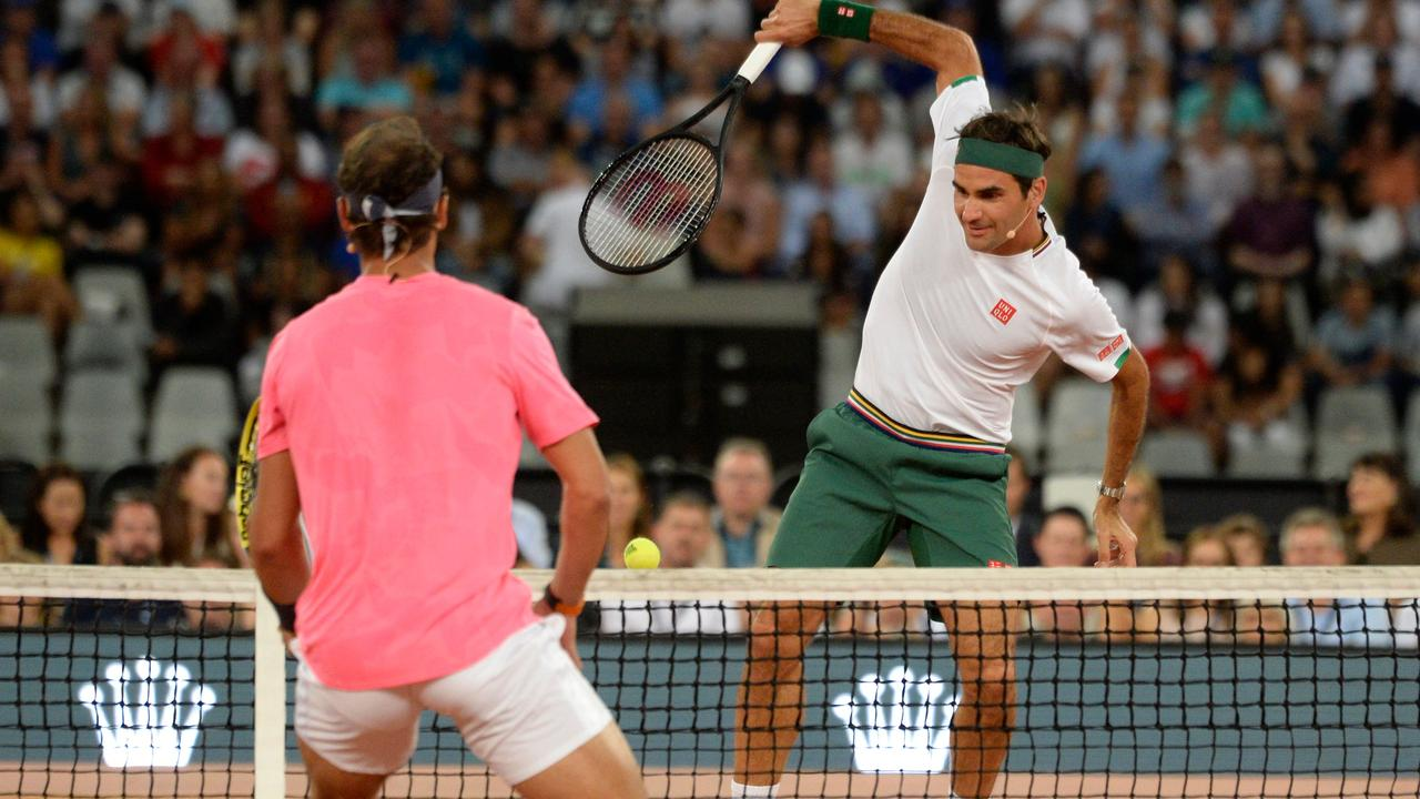 Switzerland's Roger Federer (R) plays a return to Spain's Rafael Nadal.