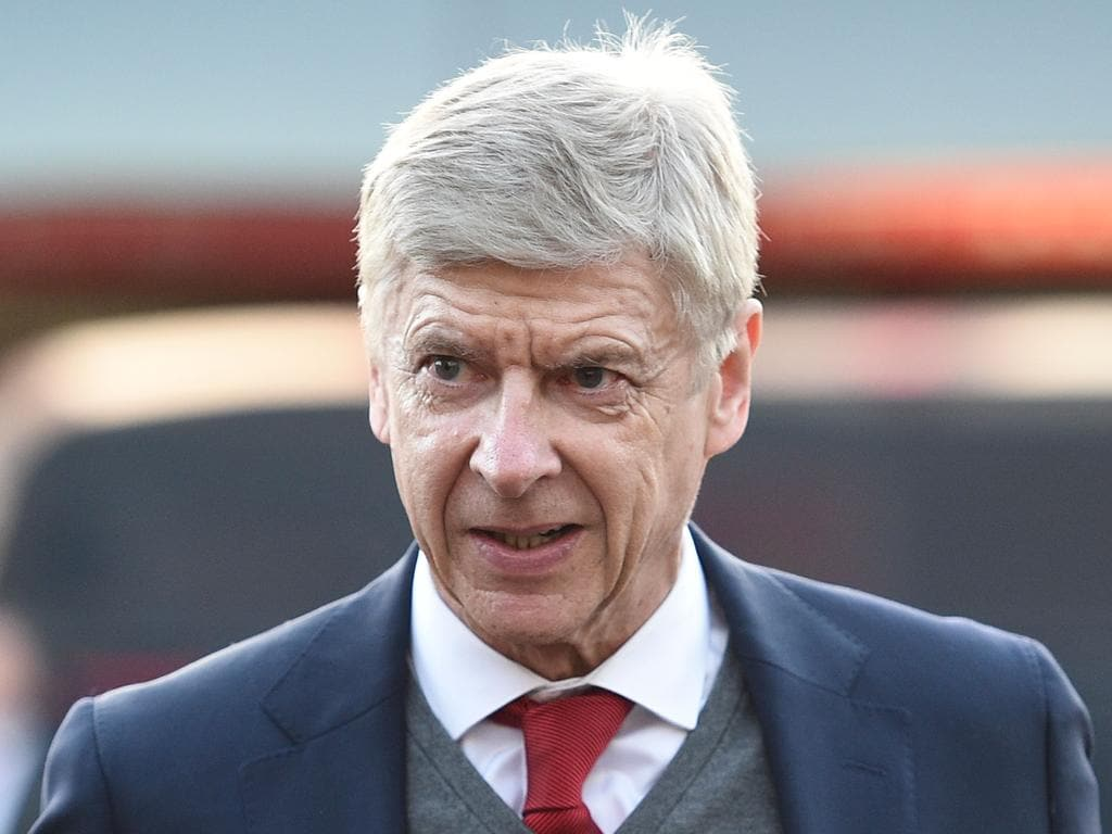 TOPSHOT - Arsenal's French manager Arsene Wenger arrives for the English FA Cup third round football match between Nottingham Forest and Arsenal at The City Ground in Nottingham, central England, on January 7, 2018. Wenger will start his three-match touchline ban at Nottingham on January 7 after being sanctioned by the Football Association over comments he made about the refereeing of Arsenal's Premier League game against West Brom last weekend. His ban will also cover the League Cup semi-final first leg at Chelsea on January 10 and next weekend's Premier League trip to Bournemouth. / AFP PHOTO / Oli SCARFF / RESTRICTED TO EDITORIAL USE. No use with unauthorized audio, video, data, fixture lists, club/league logos or 'live' services. Online in-match use limited to 75 images, no video emulation. No use in betting, games or single club/league/player publications.  /