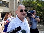Milton Orkopoulos has been charged with breaching parole a month after being released from prison.