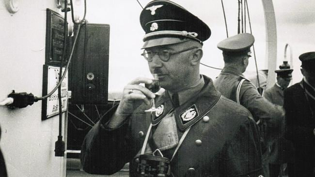 Naval tour ... Himmler sipping a drink during a Naval ship tour in Kiel, northern Germany in 1936. Pic: Realworks Ltd./Die Welt.
