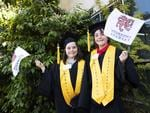 Yolla District school twins Shelby and Sheri Crocker 9 at the UTAS Graduation at Burnie. PICTURE CHRIS KIDD