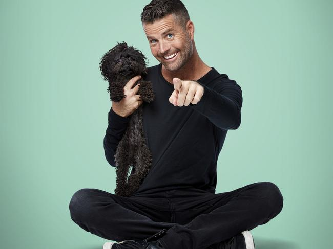 Pete Evans has launched a range of healthy pet food. Pictured, with his dog Shikoba.