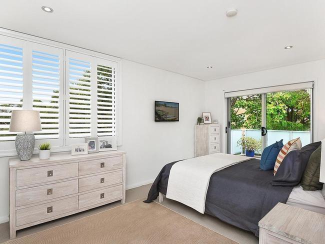 Bedroom with balcony access.