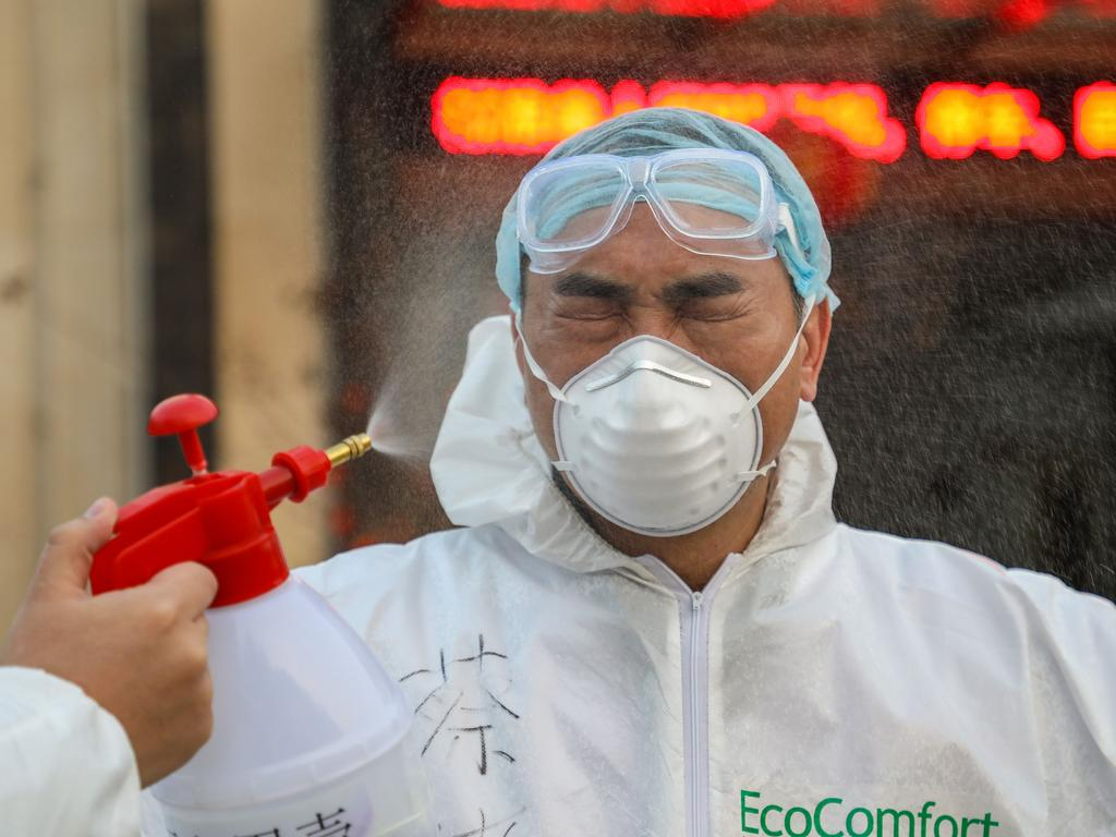 A doctor gets disinfected by his colleague at a quarantine zone in Wuhan, the epicentre of the new coronavirus outbreak. Picture: STR/AFP