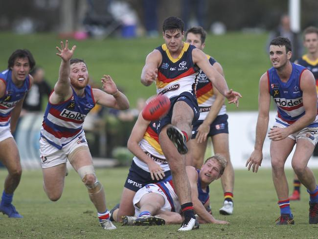 Adelaide's Darcy Fogarty gets a kick away during the Crows clash with Central District at Elizabeth Oval. Picture: AAP Image/Dean Martin