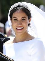 Meghan Markle leaves with Prince Harry after their wedding ceremony, at St. George's Chapel in Windsor Castle in Windsor, near London, England, Saturday, May 19, 2018. Credit: Gareth Fuller/pool photo via AP