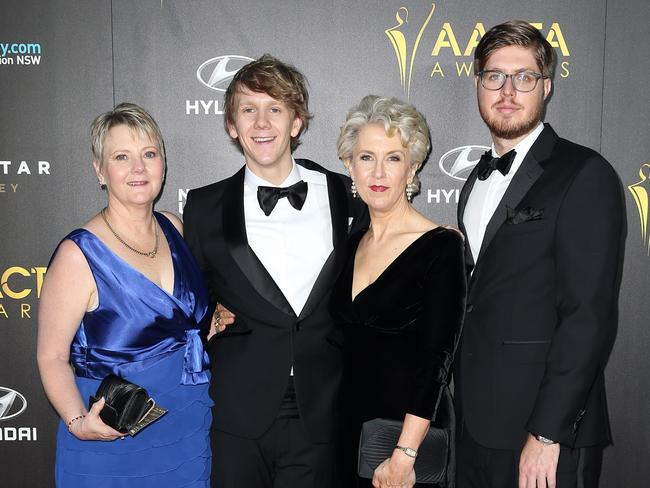 Josh Thomas with his mum (left) and the cast of Please Like Me.