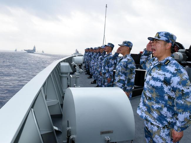 A PLA Navy fleet including the aircraft carrier Liaoning, submarines, vessels and fighter jets take part in a review in the South China Sea. Picture: Getty