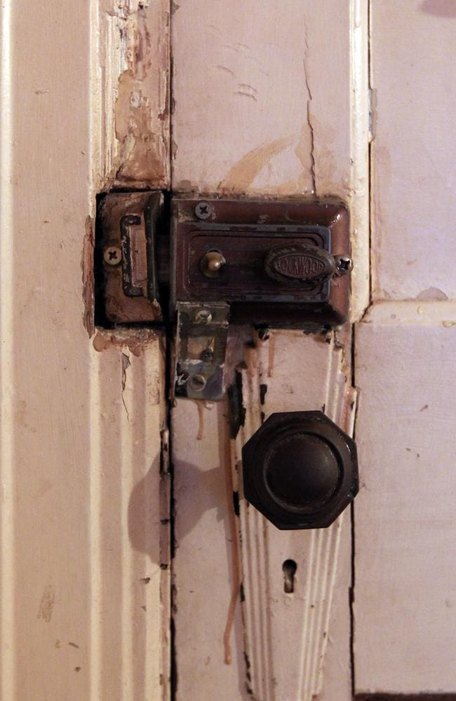 Crumbling: A door lock and handle inside a double room at the Gatwick. Picture: News Corp.