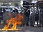 Protesters have thrown petrol bombs at riot police during protests at a Hong Kong university.
