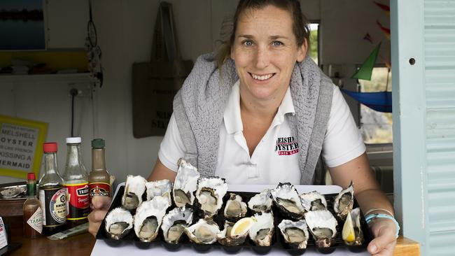 Cassie Melrose with some of the oysters produced at their farm, Melshell Oysters near Dolphin Sands. Picture: Kim Storey