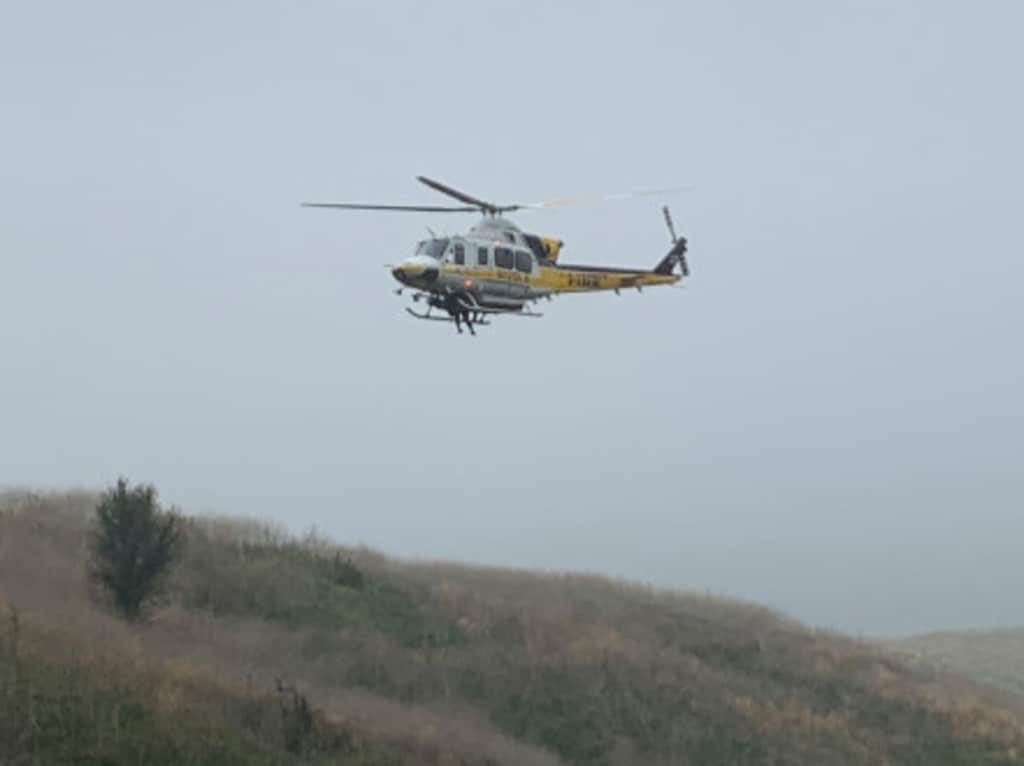 A chopper monitors the crash site.