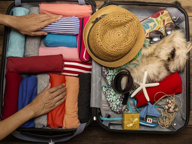 There are few things worse than lugging around a heavy and unorganised suitcase. Picture: iStock