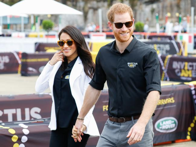 Prince Harry and Meghan hold hands as they arrive at the Invictus Games event. Picture: Chris Jackson/Getty Images for the Invictus Games Foundation.