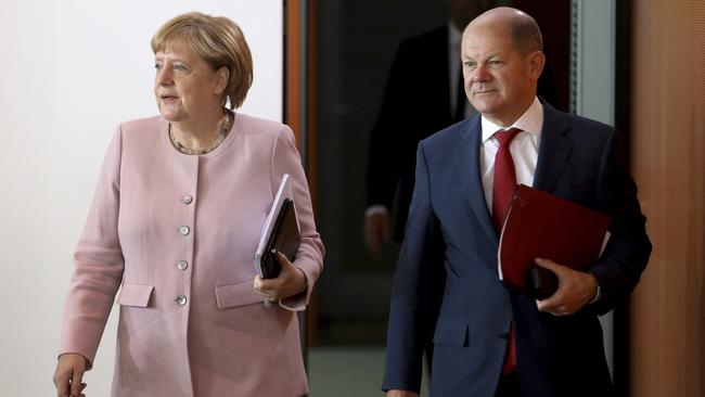 German finance minister Olaf Scholz, right. Picture: Michael Sohn/AP