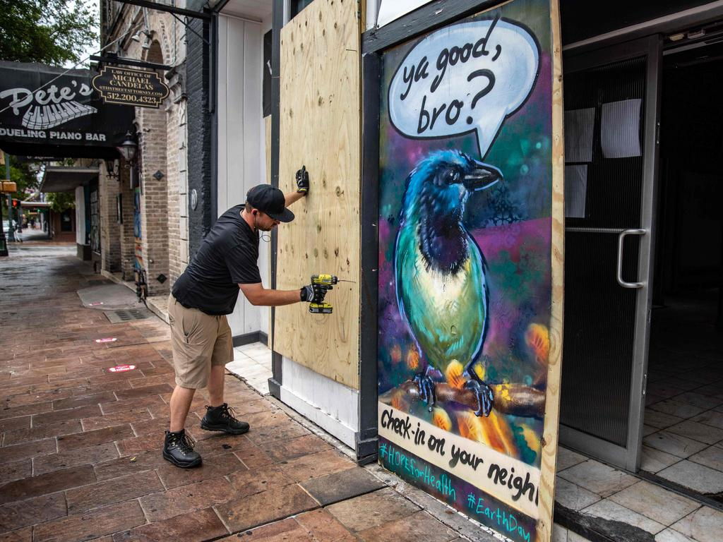 A worker boards up a bar in Austin, Texas on June 26. The city's famous bars are still not allowed to operate. Picture: Sergio Flores/AFP