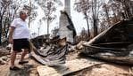 Peter Williams stands on the remains of his home which was destroyed in the New Years Eve bushfire in Mogo. Wednesday, January 15, 2020. Bushfires swept through Mogo on New Years Eve 2019 destroying several homes and businesses. Peter and Vanessa Williams lost both their home and their business which were adjacent to eachother in Mogo. (AAP Image/James Gourley) NO ARCHIVING