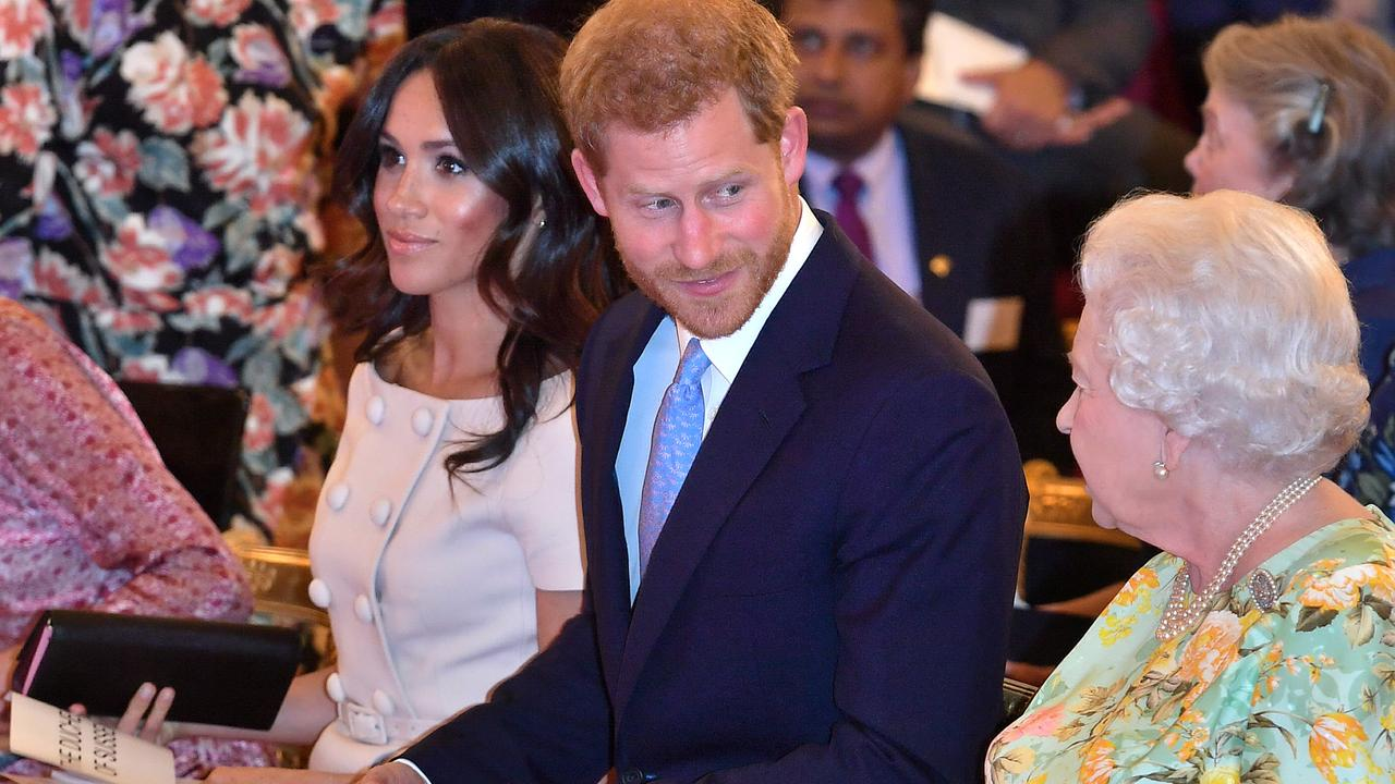 The Queen and The Duke and Duchess of Sussex attend the Queen's Young Leaders Awards ceremony at Buckingham Palace, London, on June 26. Picture: MEGA