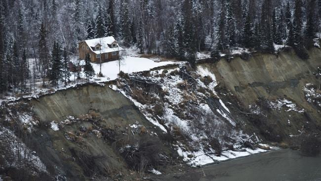 This aerial photo shows a landslide on the northwest side of Knik Arm after earthquakes in the Anchorage area, Alaska. Picture: AP